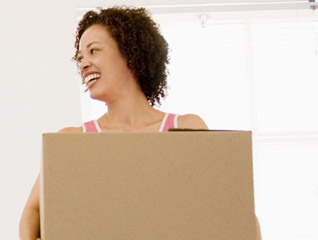 Happy woman with box