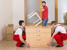 Moving team setting furniture